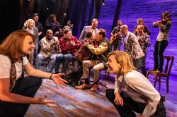 "A scene from the national company of ""Come From Away"""