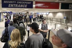 In this Wednesday, Nov. 27, 2019, file photo, travelers walk through a security checkpoint in Terminal 2 at Salt Lake City International Airport, in Salt Lake City