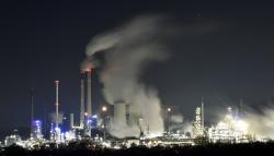 A Uniper coal-fired power plant and a BP oil refinery and chemical plant are at work in Gelsenkirchen, Germany, on Wednesday evening, Dec. 4, 2019