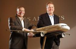 US Airways president Scott Kirby, left, and chairman and CEO Doug Parker pose for a photo at the airline's headquarters in Phoenix, Ariz. (2013)