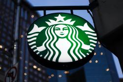 This June 26, 2019 file photo shows a the Starbucks sign outside a Starbucks coffee shop in downtown Pittsburgh