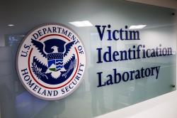 A sign to the Victim Identification Lab, part of Homeland Security's Child Exploitation Investigations Unit, is seen in Fairfax, Va., Friday, Nov. 22, 2019