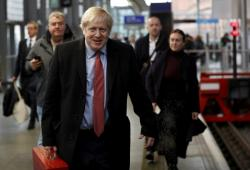 Britain's Prime Minister Boris Johnson arrives on the platform to board a train in London, Friday Dec. 6, 2019, on the campaign trail ahead of the general election on Dec. 12