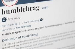 """The word humblebrag is displayed on a computer screen on Friday, Dec. 6, 2019, in New York. Merriam-Webster sums up the humble-brag nicely: """"to make a seemingly modest, self-critical, or casual statement or reference that is meant to draw attention to one's admirable or impressive qualities or achievement."""""""