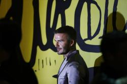 David Beckham poses for a photograph before a Christian Dior pre-fall 2020 men's fashion collection presentation during Art Basel on Tuesday, Dec. 3, 2019, in Miami