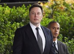 In this Wednesday, Dec. 4, 2019 file photo, Tesla CEO Elon Musk arrives at U.S. District Court in Los Angeles