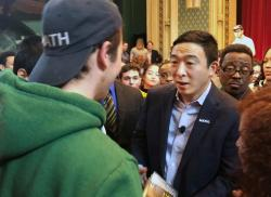 In this Dec. 5, 2019, photo Democratic presidential candidate Andrew Yang greets supporters at a campaign event at the University of Chicago in Chicago