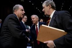 Department of Justice Inspector General Michael Horowitz, left, speaks with Chairman Lindsey Graham, R-S.C., center, and Sen. John Kennedy, R-La., right, after testifying at a Senate Judiciary Committee hearing on the Inspector General's report on alleged abuses of the Foreign Intelligence Surveillance Act, Wednesday, Dec. 11, 2019, on Capitol Hill in Washington