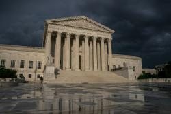 In this June 20, 2019 file photo, The Supreme Court is seen under stormy skies in Washington.