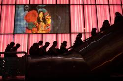 Shoppers at a retail district pass by an American lingerie company Victoria's Secrets store in Beijing on Friday, Dec. 13, 2019.