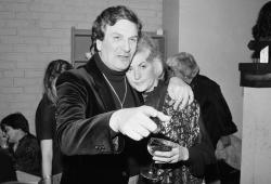 """In this April 28, 1981 file photo, Actor Danny Aiello hugs actress Beatrice Arthur at a party following their opening performance in Woody Allen's play, """"The Floating Lightbulb,"""" in New York"""
