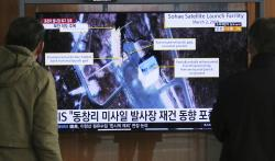 In this March 6, 2019, file photo, people watch a TV screen showing an image of the Sohae Satellite Launching Station in Tongchang-ri, North Korea, during a news program at the Seoul Railway Station in Seoul, South Korea