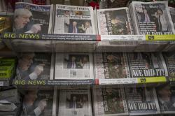 Newspapers sit on display for sale with their front pages reporting on the general election in a supermarket in south west London, Saturday, Dec. 14, 2019.