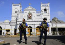 In this April 22, 2019, file photo, Sri Lankan Navy soldiers stand guard in front of the St. Anthony's Shrine in Colombo, Sri Lanka