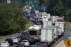 In this Aug. 12, 2016, file photo, traffic crawls eastbound on Interstate 84 in Sturbridge, Mass., after an overnight accident involving two tractor-trailers on the Massachusetts Turnpike