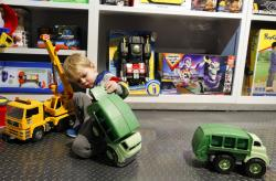 Maxwell MacIsaac, 2, plays with trucks at Camp toy store in New York.