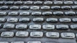 In this Dec. 5, 2018 file photo, hundreds of Chevrolet Cruze cars sit in a parking lot at General Motors' assembly plant in Lordstown, Ohio