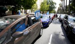 In this Aug. 28, 2019, file photo, dozens of supporters of a measure to limit when companies can label workers as independent contractors circle the Capitol during a rally in Sacramento, Calif.