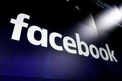 This March 29, 2018 file photo, shows the logo for social media giant Facebook at the Nasdaq MarketSite in New York's Times Square