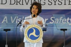 In this Sept. 12, 2017 file photo, U.S. Transportation Secretary Elaine Chao announces new voluntary safety guidelines for self-driving cars during a visit to an autonomous vehicle testing facility at the University of Michigan, in Ann Arbor, Mich.