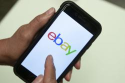In this July 11, 2019, file photo, an Ebay app is shown on a mobile phone in Miami