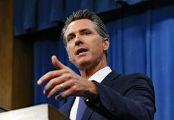 In this July 23, 2019, file photo, Gov. Gavin Newsom talks to reporters at his Capitol office, in Sacramento, Calif.