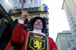 Beefeater doorman Tom Sweeney points up Powell Street while standing outside the Sir Francis Drake Hotel in San Francisco.