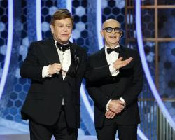 Elton John, left, and Bernie Taupin at the 77th Annual Golden Globe Awards at the Beverly Hilton Hotel in Beverly Hills, Calif.