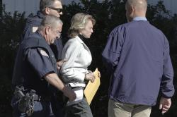 In this Sept. 19, 2019, file photo, Michelle Carter, center, arrives for a parole hearing in Natick, Mass.