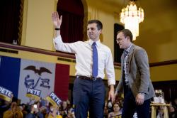 Democratic presidential candidate former South Bend, Ind., Mayor Pete Buttigieg, left, and his husband Chasten Buttigieg, right, stand onstage at a campaign stop at Iowa State University.