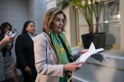 Speaker of the House Nancy Pelosi, D-Calif., arrives to meet with the Democratic Caucus at the Capitol in Washington.