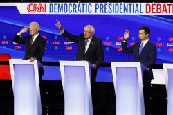 From left, Democratic presidential candidate former Vice President Joe Biden, Sen. Bernie Sanders, I-Vt.,and former South Bend Mayor Pete Buttigieg look to answer a question Tuesday, Jan. 14, 2020, during a Democratic presidential primary debate hosted by CNN and the Des Moines Register in Des Moines, Iowa