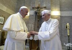 Pope Francis, left, and Pope Benedict XVI, meet each other on the occasion of the elevation of five new cardinals at the Vatican.