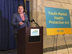 Filmmaker Zach Meiners speaks at a rally on Tuesday, Jan. 14, 2020, in Frankfort, Ky., in support of legislation aimed at effectively banning the practice of conversion therapy in Kentucky.