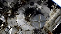 In this image taken from NASA video NASA astronaut Jessica Meir works to finish upgrading the International Space Station's power grid, Wednesday, Jan. 15, 2020
