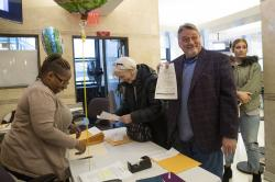 April Green, left, a public records aide, helps Joan Morgan, center, of Mt. Kisco, N.Y., and Joseph Pessolano, second from right, from the borough of Staten Island, as they file their pre adoption birth certificate application, Wednesday, Jan. 15, 2020, in New York