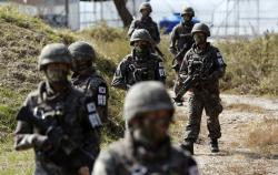 South Korean Army soldiers patrol during the demonstration of search operation at a training field near the demilitarized zone (DMZ) in Cheorwon, South Korea.