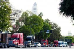 In this Nov. 13, 2009, file photo a caravan of trucks from the ports of Los Angeles and Long Beach, Calif., drive around Los Angeles City Hall during a protest against container fees being assessed against independent truckers