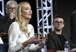 "Karlie Kloss speaks as Christian Siriano looks on in Bravo's ""Project Runway"" panel during the NBCUniversal TCA Winter Press Tour."