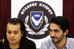 Kevork Tontian, right, and Wemson Gabral da Costa talk during an interview inside Cyprus' prison complex in capital Nicosia, Cyprus, on Jan. 16, 2020