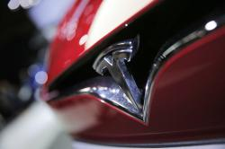 This Sept. 30, 2016, file photo shows the logo of the Tesla model S at the Paris Auto Show in Paris, France