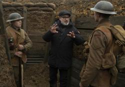 """Dean-Charles Chapman, left, director Sam Mendes, center, and George MacKay on the set of """"1917."""""""