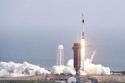 A Falcon 9 SpaceX rocket lifts off from pad 39A during a test flight to demonstrate the capsule's emergency escape system at the Kennedy Space Center in Cape Canaveral, Fla., Sunday, Jan. 19, 2020