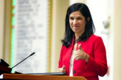 In this Jan. 8, 2020 file photo, House speaker Sara Gideon, D-Freeport, flashes a thumbs up at a Democratic colleague prior to the start of the first session of the new year at the State House House in Augusta, Maine
