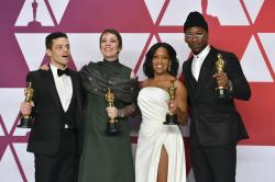 "Oscar winners, from left, Rami Malek, for best performance by an actor in a leading role for ""Bohemian Rhapsody"", Olivia Colman, for best performance by an actress in a leading role for ""The Favourite"", Regina King, for best performance by an actress in a supporting role for ""If Beale Street Could Talk"", and Mahershala Ali, for best performance by an actor in a supporting role for ""Green Book"", holding their awards in the press room at the Oscars in Los Angeles."