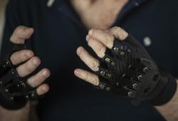 Brazilian pianist Joao Carlos Martins poses for pictures wearing bionic gloves, at his home in Sao Paulo, Brazil, Wednesday, Jan. 22, 2020