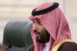 In this Oct. 14, 2019 file photo, Saudi Arabia's Crown Prince Mohammed bin Salman speaks to Russian President Vladimir Putin during the talks in Riyadh, Saudi Arabia