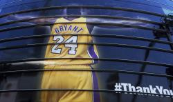 In this April 13, 2016 file photo a giant banner congratulating Kobe Bryant is draped around Staples Center before his last NBA basketball game