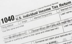 This July 24, 2018, file photo shows a portion of the 1040 U.S. Individual Income Tax Return form.