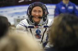 In this Thursday, March 14, 2019 file photo, U.S. astronaut Christina Koch, member of the main crew of the expedition to the International Space Station (ISS), speaks with her relatives through a safety glass prior the launch of Soyuz MS-12 space ship at the Russian leased Baikonur cosmodrome, Kazakhstan